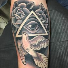 All seeing eye and white dove tattoo on the arm - Styleoholic