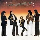 Journey...I sure wish Steve Perry was still with the band.  I saw them without him, still good music...