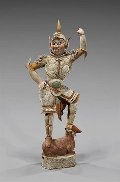 """Beautifully detailed, Chinese Tang Dynasty painted pottery Lokapala; depicted in a fierce stance, standing atop a recumbent ram, and dressed in fine armor with qilin motif shoulders; H: 55 1/2""""; with Oxford TL Report #C202b59"""