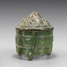 """HAN DYNASTY GREEN GLAZED """"HILL"""" CENSER with cover; the cylindrical body exterior with band of moulded animals in relief, the cover with stylized, wavy """"hill""""; with some iridescence throughout; H: 9"""";"""