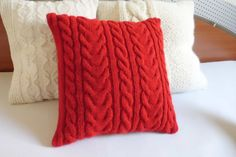 This is a listing for a custom hand knit pillow cover in pure red color with an intricate cable stitch design on front and back as well.  The