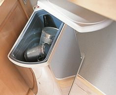Slim Waste Bin Stainless Steel. A compact bin that opens with the door. #storagesolutions