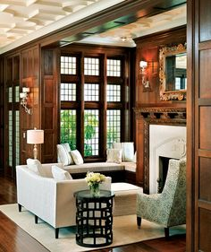 Gorgeous Seating area in a Library or Living Room with Beautiful Ceiling Mouldings & Millwork