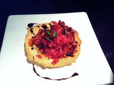 Homemade olive oil crispbread, dijon mayonnaise, topped with raw grated carrot, beetroot, kohlrabi and a squeeze of lemon, decorated with balsamic glaze and sprouted onion shoots.