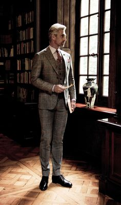 A broodingly dark image of a sharp three piece suit by Canali.