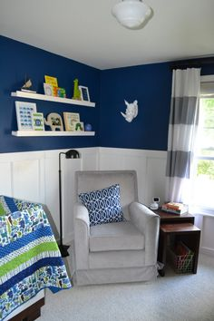 Nursery Tip: If you want a bold color in the nursery, consider adding a white wainscoting to tone down the color. How amazing is this navy blue?! #babyroom