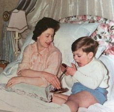 Queen Elizabeth II and a young Prince Andrew, in bed c. 1964