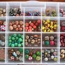 """I love to make rather large polymer clay beads but the bigger the bead, the heavier the weight, which is no good for jewelry. I decided using a wood """"filler"""" ..."""