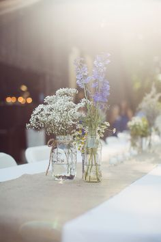 This is perfect. I'm not sure yet if we can afford the flowers though. I love the combination of baby's breath with just a little bit of purple and greenery over the burlap.