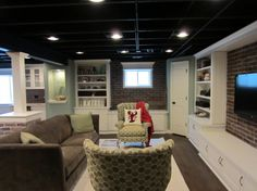Basement, This is our recently finished basement digs.  We were intent on keeping it from going too dark, so we chose white woodwork & trim with brick accents.