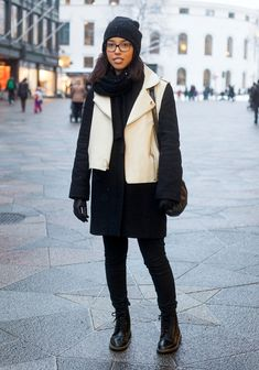"""Lulee, 29  """"I'm wearing a Monclair coat with a vest from H&M and a bag by Ann Demeulemeester. I like to wear black-and-white, because it's simple, clear and allows you to play with materials and cuts."""" 9 February 2013, Keskuskatu"""