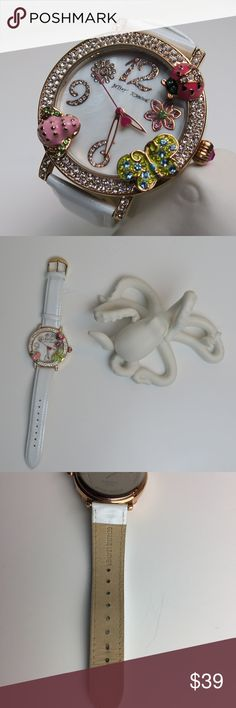 Betsey Johnson Bug Watch Pre-loved: Leather strap has bend to it.  Please refer to photos for more detail. Watch does not come with box.  White leather strap.  Round critter and crystal-set rose gold-tone stainless steel case, 44mm.  White dial with rose gold-tone numeral and flower crystal markers.  Quartz movement. Betsey Johnson Accessories Watches