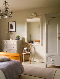 Relaxing bedroom painted in Farrow and Ball Old White with sparkly Venetian mirror by Sarah Crozier Design #vintagestyle #Frenchstyle