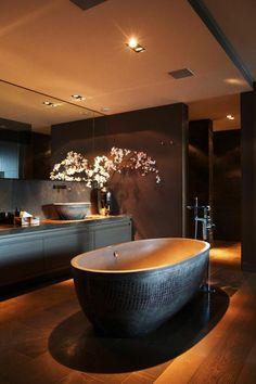 Dark toned, free standing tub, bathroom