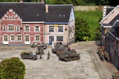 Outdoor wargaming with 60 mm figures; German forces in a Flemish town
