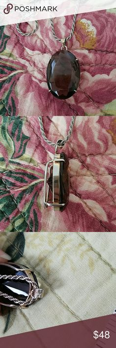 "Sterling Silver Smoky Quartz Necklace Beautiful Sterling Silver & Genuine Smoky Quartz Necklace. Pendant is Stamped Silv. & Chain is Stamped 925 Italy.  This is a Gorgeous Pendant. Large in Size. There is A Minor Light Scratch on Stone But is Not  Visible to the Naked eye.  Tried to Capture it in Photo 6. Does not Take Away the Beauty of this Piece.  Just Wanted to Point it out.  Chain is Approximately 20"" in Length.  Nice Weight to Chain. Jewelry Necklaces"