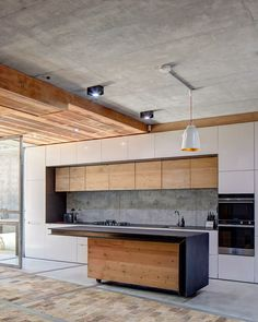Kitchen design in concrete and wood