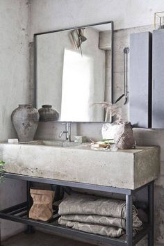SEE ALL | 7 OF 15 Industrial Rustic A chunky concrete vanity top and sink with metal base give an industrial-rustic vibe. Notice how the walls are cement, too. The glossy chrome faucet adds a refined touch. ai large bud vase $10.95 Pewter Stoneware Soup Tureen $275 Pewter Stoneware Creamer $42 Pewter Stoneware Lidded Sugar Bowl $42 Horn Sconce with Shade $629.99 Ye Ol' Goat Soap - Lemon + Verbena $13.99 Ye Ol' Goat Soap - Bergamot + Teak $13.99 Ten Vesse