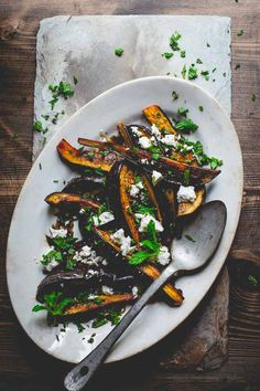 roasted eggplant with pomegranate molasses feta and mint via @healthyseasonal