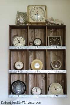 Vintage Clock Collection Display - love them in the rustic cubbies eclecticallyvintage.com