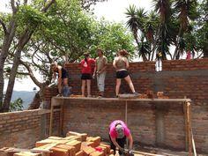 The University brigade working on building a school in Honduras.