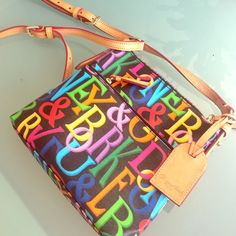Dooney & Bourke Over-the-Shoulder Purse Beautiful and colorful leather D&B purse. Long and adjustable over-the-shoulder strap. Can be work cross-body. Lots of detail including colorful zipper! Such a fun bag! Dooney & Bourke Bags Crossbody Bags