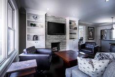 Living room featuring an @ErthCOVERINGS Silver Fox Strips fireplace! @Bryan_Baeumler