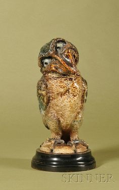 """Martin Brothers Stoneware """"Wally-bird"""" Tobacco Jar and Cover, both cover and base dated March, 1888, enamel decorated, the inquisitive bird with head tilted to the left and with wings put back, all in tones of brown, blue, and green, on an ebonized circular base, overall ht. 14 1/8 in."""