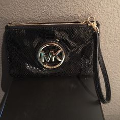 "Michael Kors wristlet Michael Kors Fulton Wristlet, Black Python. Some scratches on the MK logo but in very good condition otherwise. No stains, rips or tears.  Made of leather. Approx. 7"" x 4"" Zip-top closure. Interior slip pockets Fabric lining. Gold tone hardware. Michael Kors Bags Clutches & Wristlets"