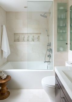 Toronto Interior Design Group Contemporary bathroom with seamless glass shower door, travertine tiles shower surround, rain shower head, Eames Walnut Stool and espresso stained bathroom vanity with white quartz countertop.