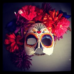 dia de los muertos mask made of plaster and fake flowers