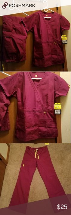 Brand New Tag On Wonder Wink Scrubs Perfect never worn tag on wine colored scrubs. Reposh, pants were too small on me, just want what I paid. Cargo style pants inseam 30 in. Wonder Wink Pants