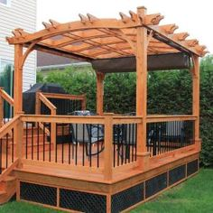 Ideal for placement in an outdoor setting, this Outdoor Living Today Arched Breeze Cedar 10 ft. x 12 ft. Pergola with retractable canopy stylishly accents a yard and provides an elegant western red cedar Diy Pergola, Cedar Pergola, Retractable Pergola, Building A Pergola, Pergola Canopy, Deck With Pergola, Canopy Outdoor, Outdoor Pergola, Wooden Pergola