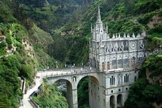 El Santuario de la Virgen del Rosario de Las Lajas en Ipiales. The current church was built between January 1, 1916 and August 20, 1949, with donations from local churchgoers. It rises 100 m high from the bottom of the canyon and is connected with a 50 m tall bridge to the opposite side of the canyon. Thus, the Cathedral has become the key to peace and Union between the two South American Nations. (viola.bz)