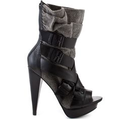 This peep toe bootie from Report Signature will make you feel like you stepped out of a fashion magazine.  Hancock has a grey fabric upper adorned with black buckles and straps.  This edgy bootie has a 5 inch heel and a 1 inch platform.