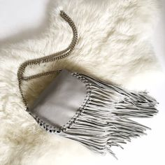 Zara Grey Fringe Crossbody Bag- Silver Chain Strap This dove grey beauty is available just in time for Festival Season! It's 100% genuine leather and features a durable silver chain strap that can be tucked into the bag and worn as a clutch. New with tags. ❗️NO TRADES❗️ Zara Bags Crossbody Bags