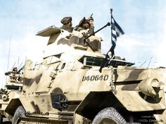 1943- Greek soldiers in a Marmon-Herrington Mk III armored car during maneuvers somewhere in the Middle East. by Markos Danezis