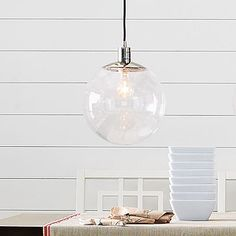Love this globe pendant from #WestElm  -- thinking about something like it for the front hall, but not sure if it'd look out of place there. Thoughts?
