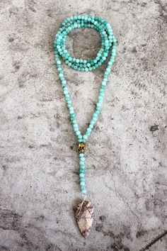 Chrysoprase beaded necklace with brass skull and arrowhead pendant