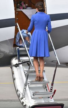 Princess Charlotte takes a tumble as she boards the plane with her mother The Duchess of Cambridge at the Chopin airport as they depart to Berlin, in Warsaw in July 2017