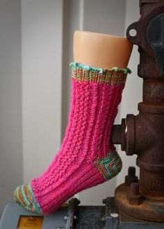 Cupcake Socks They look like the body is knit and the heel crocheted.I like them and may have to get this pattern and find out how they are done.