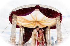 This beautiful Indian wedding ceremony is a traditional event held outdoors.