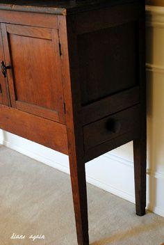 living room. black walnut cupboard. detail of legs.