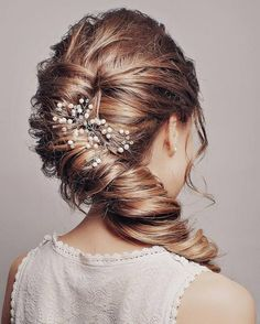 Long Wedding Hairstyles & Bridal Updos via Evgeniya Lebedeva / http://www.himisspuff.com/wedding-hairstyles-from-evgeniya-lebedeva/4/