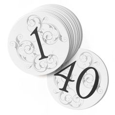 Filigree Wedding Table Number Card Set includes 40 table number signs each printed with a different number from 1-40 in black. They are round in shape and made from sturdy white cardstock. They also feature a beautiful filigree design in a lighter color.