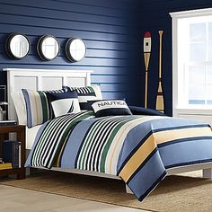 Create a crisp, refreshing atmosphere in your bedroom with the Nautica Dover Comforter Set. Adorned with horizontal bands of green, chambray and yellow, the stunning, striped bedding instantly brings a clean, relaxed feel to any room's décor.