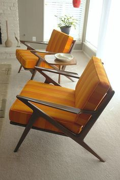 "Selig Z chairs.  ""The design of the Selig Z chair is often attributed to three Danish furniture designers, Finn Juhl, Poul Jensen and Ib Kofod Larsen. The Selig Z chairs were typified by their sweeping lines and were built of very high quality wood. As a result, Selig Z chairs are excellent examples of vintage Danish design and many are still available in useable condition."""