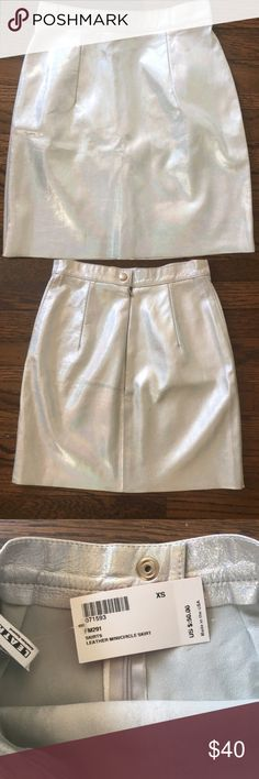 Silver Holographic Genuine Leather Genuine Leather skirt. Minor scratch! Not noticeable other than that excellent shape. Never worn. Best fits a 25 inch waist (or very close to it). No longer sold! American Apparel Skirts Mini