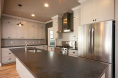 Kitchen features Honed Black Granite Countertops, Light Gray Cabinets & Tile Backsplash, WalkIn Pantry, and Professional Series Stainless Appliances