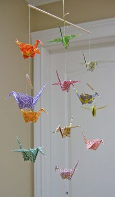 Super cute easy origami crane mobile. Easy way to spice up your room!!